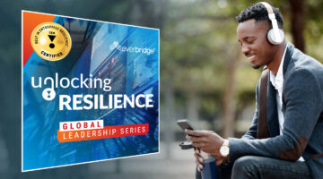 everbridge-Unlocking-Resilience-man-listening with headphones and podcast cover art