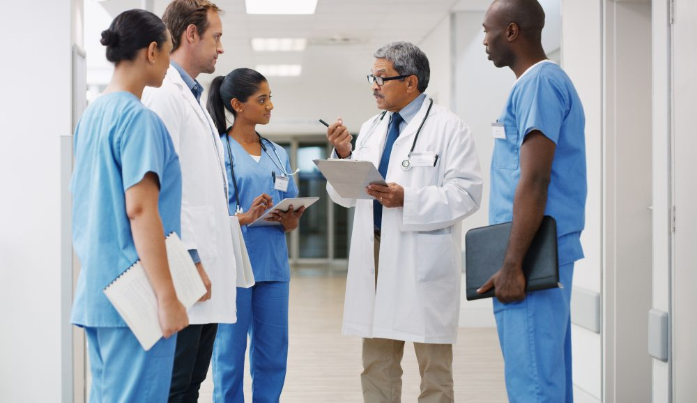 Shot of a group of medical practitioners having a discussion in a hospital