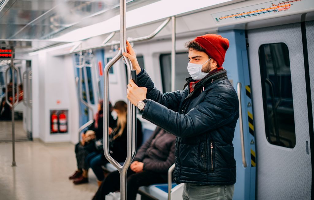 Man Wearing a Sterile Mask in the Subway