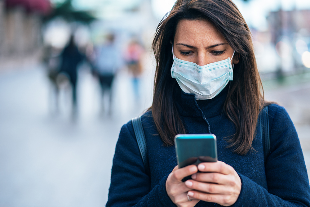 coronavirus woman mask on phone