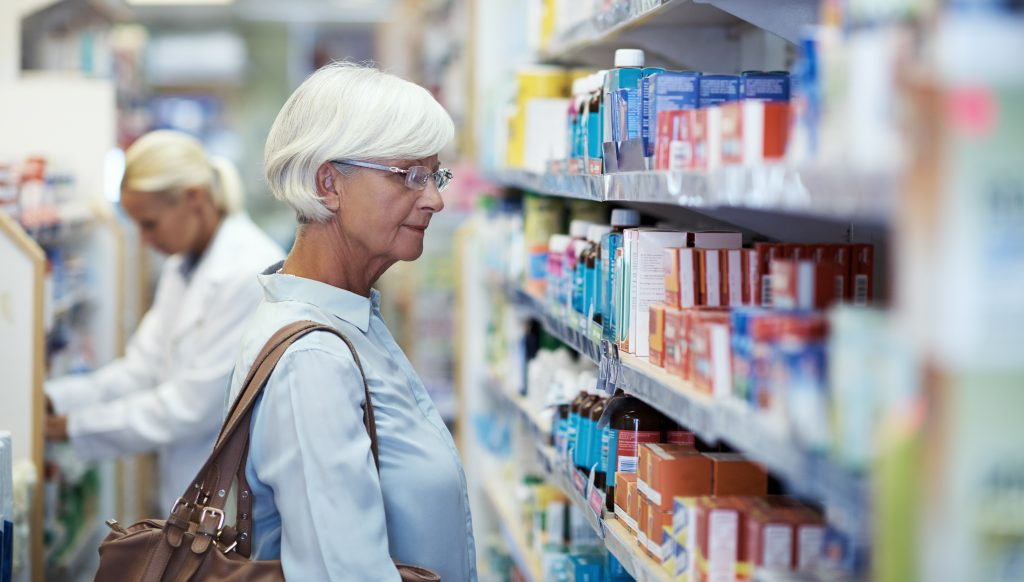 treatment Shot of an elderly woman looking at products in a pharmacy
