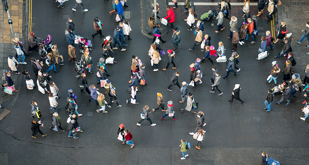 Pedestrian crowds crossing the street - photographed from directly above