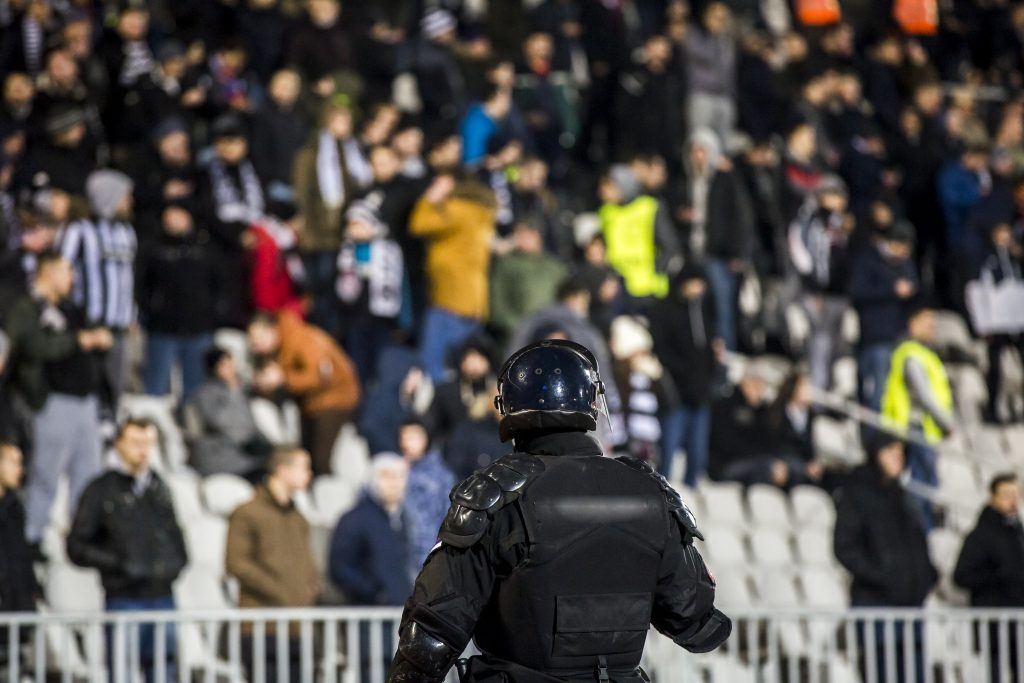 Special police unit at the stadium event secure a safe match against the hooligans
