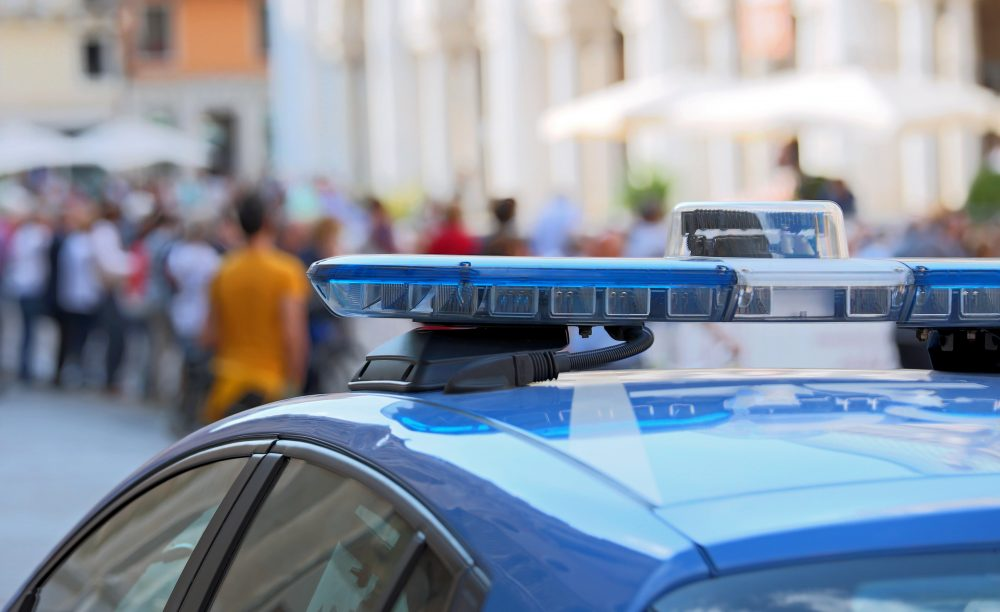 Police car with blue sirens in the main square