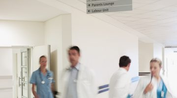 Doctors and nurses walking in hospital corridor