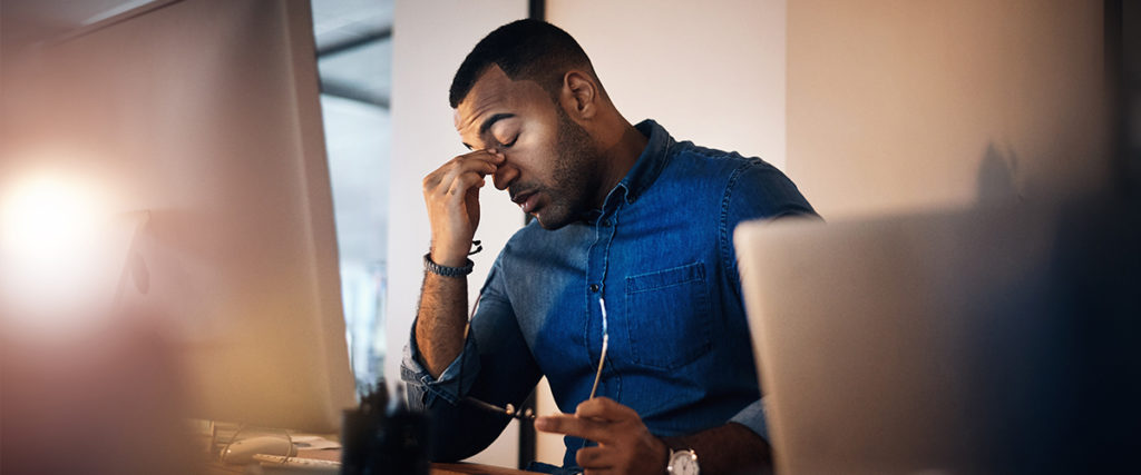 man working at computer stressed