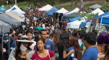 UC Irvine students visiting booths at the Anteater Involvement Fair in Aldrich Park