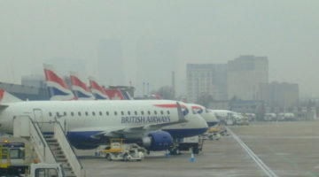 British Airways plane parked at a foggy airport